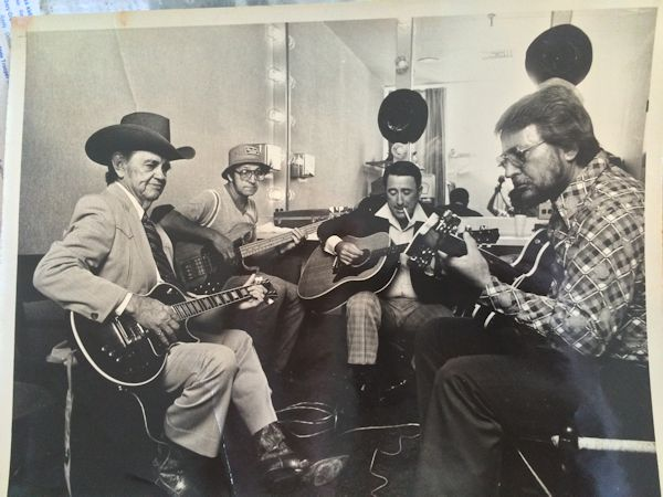 Merle Travis, Reggie Alley, Jack Kirby and Joe Carroll backstage at the Opry rehearsing for a performance – October 1982